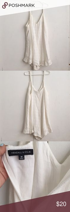 Kendall and Kylie Romper Cream/Ivory Romper with a V-Neck and ruffle bottom. I have worn it once and it has been sitting in my closet unused for years. Kendall & Kylie Dresses Mini