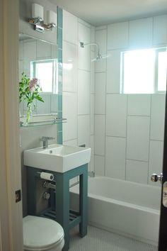 "Contemporary Full Bathroom with White penny tile (porcelain), Lamps plus frameless rectangular 40"" high beveled wall mirror"