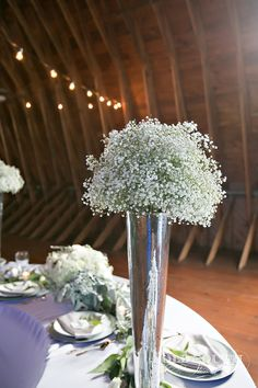 Love this silver and white floral centerpiece! | Charlotte wedding, Charlotte wedding vendors, ceremony decor, silver, green, NC wedding, NC wedding vendors | Photographer @oldsouthstudios Rentals @Csspecialevents Planner @minttobewedding Men's Attire @mwtuxedo