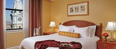 Gaze out at magnificent Philadelphia landmarks from under luxurious covers in a plush featherbed at The Ritz-Carlton, Philadelphia.
