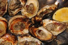 Grilled Oysters with smoked bacon and compound butter