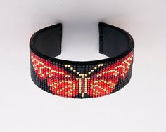 Beaded Red and Gold Butterfly Design Bracelet on a Black Background. This piece dresses up any Outfi Loom Bracelet Patterns, Bead Loom Bracelets, Bead Loom Patterns, Jewelry Patterns, Bracelet Designs, Beading Patterns, Tear, Beads And Wire, Baby Dresses