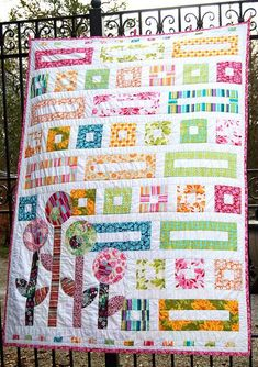 Love the bright colours and the flowers in the corner to switch things up a bit. (UK I'm Blushing by Lynne @ Lilys Quilts, via Flickr)
