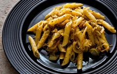 Pasta with caramelized cabbage, anchovies and bread crumbs.