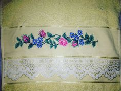 Face towel embroided with cross stitch