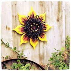 "Capturing the sun with its distinct golden petals and black center, this 25"" sunflower sculpture mimics a perennial garden staple. 🌻 25"" diameter; Ready to hang; indoor/outdoor display. On sale now, 15% OFF & Free Shipping. See it here:  #rusticdecor #bhgflowers #flowerartist #artinprogress #gardenlife"