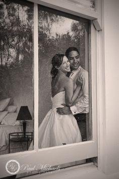 Bride and groom through the window. Wedding photographer, Wellington, New Zealand. http://www.paulmichaels.co.nz