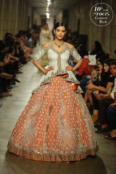 orange and cream lehenga design | white high low peplum blouse - beautiful design! | Manav Gangwani Indian Wedding Couture Fashion