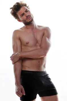 After Charlie Hunnam sensationally pulled out of Fifty Shades of Grey, Jamie Dornan has been brought in to replace him. Dornan will be starring alongside Dakota Johnson as Christian Grey. Jamie Dornan, Mr Grey, Charlie Hunnam, Christian Grey, Calvin Klein Models, Poses References, Fifty Shades Of Grey, Gorgeous Men, Beautiful People