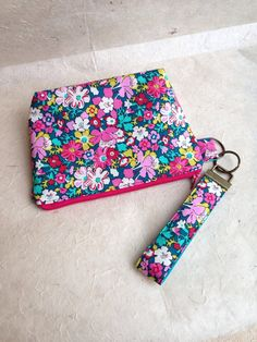 Purse and Key Fob Wristlet Keyring made with Liberty of London Lytton fabric.  The purse measures approximately 8x 6 with a 1.5 box bottom. It is