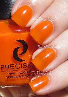 """""""Orange She Hot!? is a neon orange. It's a bit darker of an orange when compared to Kiss Kiss Tang Tang. This was also a bit on the sheer side but not as sheer as some of the others in the collection. The formula overall was good, it was easy to work with and the consistency of the polish was good. I used 3 coats for the photos below."""""""