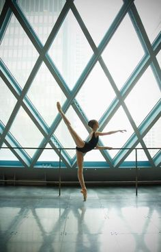 Beautiful lines... the ballerina, and the lines of the windows!