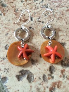 Adorable layered orange starfish earrings with by RealBeadDesigns