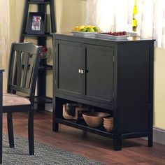 @Overstock.com - Montego Black Wooden Buffet - This buffet from Montego will enhance you kitchen or dining area. This buffet features two doors with an adjustable shelf cabinet and open shelf under the cabinet for ease of use.  http://www.overstock.com/Home-Garden/Montego-Black-Wooden-Buffet/5998189/product.html?CID=214117 $152.99