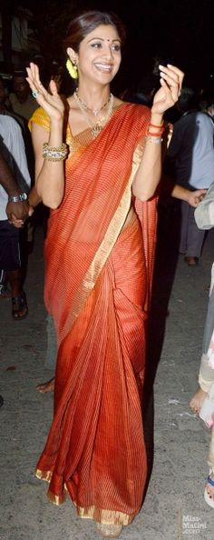 Sept, 2013: Shilpa Shetty in Red, Gold & Mustard bidding farewell to Lord Ganesha