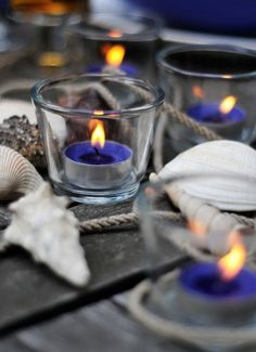 blue candles for a summer beachy look (or purple for the wedding)
