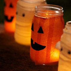 Great Halloween DIY craft. Create jack-o-lantern votives with mason jars, crepe paper and sticky felt. Cover a mason jar with spray adhesive, wrap crepe paper around the jar and use sticky felt to add a face.