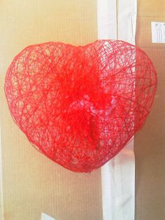 wrap heart shaped balloon with red string soaked with 50%water dry then pop balloon