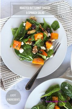 A flavorful spinach salad made with roasted butternut squash, dried cranberries and walnuts for a flavorful fall salad perfect for a holiday side dish