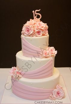What a lovely and sweet cake for a Quinceanera celebration! The subtle colors of pink makes this a very elegant cake.