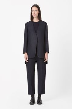 Made from textured wool-mix, this oversized blazer has a modern split back. Crossing over at the front, it is a clean A-line shape with a deep v-neckline, hidden press stud fastening and a modern graduated hemline. Oversized Blazer, Cos, Casual Chic, Hemline, Normcore, Fashion Outfits, Stylish, Jackets, Clothes