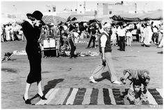 At the Marrakech market in 1992, Grace Coddington and photographer Ellen von Unwerth styled Nadja Auermann as Marlene Dietrich in Morocco Photographed by Ellen von Unwerth, Vogue, 1992