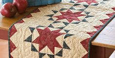 A Classic Design to Make Up In Your Favorite Colors! Richly colored prints combine in a country-style topper. Display this little quilt all year around or just for patriotic holidays. The versatile pattern can take on many looks depending on your fabric choices. Bright modern fabrics, retro prints, batiks and more will look wonderful in …