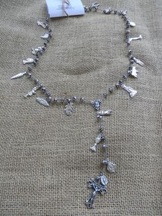 Grey Glass Beaded Rosary with Silver Milagros Approximately 20.5 Inches (52 Centimeters)  Segundo Milagro gringagordon@gmail.com  #milagro #milagros #spirit #christian #catholic #religious #jewish #blessing #altars #altar #miracle #charm #charmed #blessed #divine #mexico #saints #mexican #sale #gift #custom #folk #art #handmade #artifact #faith #prayer #chic #fashion #jewelry #silver #necklace #rosary