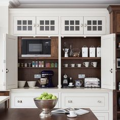This cabinet, by Humphrey Munson, creates a generous space to serve as a coffee station or storage for for small countertop appliances. Wide, bi-fold doors fold back out of the way to allow the homeowner full access to a large interior work surface. Pantry Cupboard, Kitchen Pantry, New Kitchen, Kitchen Storage, Kitchen Dining, Baking Cupboard, Bathroom Storage, Dining Area, Kitchen Ideas