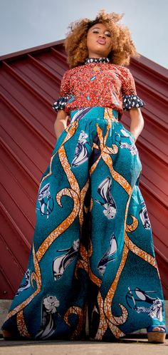 Finally an African print palazzo pants that looks just as chic as it is stylish. This blend of Ankara fabric and polka dot ruffles was done to perfection! Ankara | Dutch wax | Kente | Kitenge | Dashiki | African print dress | African fashion | African women dresses | African prints | Nigerian style | Ghanaian fashion | Senegal fashion | Kenya fashion | Nigerian fashion | wide leg pants