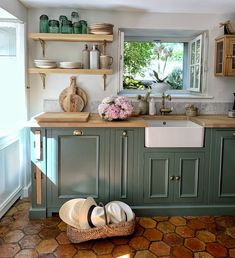 Such a stunning spring kitchen! Imagine looking out to your garden from your sink top window so cozy! Sage Kitchen, Farmhouse Style Kitchen, Kitchen Redo, Home Decor Kitchen, Rustic Kitchen, Kitchen Interior, Kitchen Remodel, French Country Kitchens, Kitchen Paint