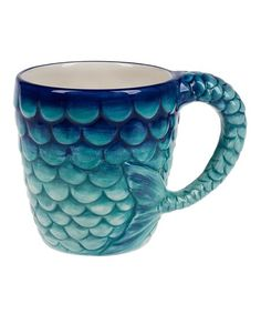A unique-chic shape brings a playful feel to your morning java jolt in this eye-catching mug.