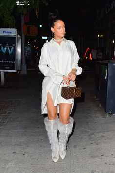 The singer stepped out last night in NYC wearing a long-sleeved shirtdress, Louis Vuitton box bag, knee-high fur boots, a chain necklace and hoop earrings.