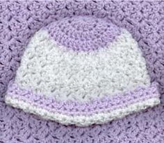 This is another fabulous delicate hat. It has booties to match! But the photo is blurry and hard to tell. Take another look.