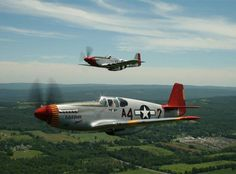 P-51 Mustangs. C version in foreground. D version in background. Part of the famous Red Tail squadron.