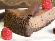 Low fat triple chocolate cheesecake because double the chocolate is just not quite enough. Triple Chocolate Cheesecake, Low Fat Chocolate, Yummy Treats, Yummy Food, Tasty, Healthy Food, Chocolate Graham Cracker Crust, Sweet Recipes, Yummy Recipes