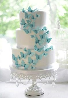 Something Blue...Butterflies on White Chandelier Cake Stand by Opulent Treasures See more here: http://www.opulenttreasures.com/shop/chandelier-round-cakes-set-of-3