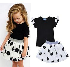 $15.12 (Buy here: https://alitems.com/g/1e8d114494ebda23ff8b16525dc3e8/?i=5&ulp=https%3A%2F%2Fwww.aliexpress.com%2Fitem%2FHot-sale-girls-dress-sets-2016-summer-new-arrivel-models-children-clothes-cute-cotton-girls-bow%2F32645054486.html ) Hot sale girls dress sets 2016 summer new arrivel models children clothes cute cotton girls bow T-shirt + flower skirt suit for just $15.12