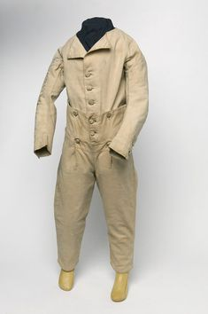 Skeleton suit 1800-1805:  England: Boy's skeleton suit of a pale yellowish cloth known as nankeen. The jacket has elbow length sleeves and a button through front, the trousers ankle length legs and a button through small fall front.