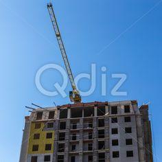 Qdiz Stock Photos | Building crane on construction,  #architecture #blue #build #building #built #business #City #construct #construction #crane #development #engineering #equipment #estate #growth #house #industrial #industry #modern #site #sky #steel #technology #urban #work