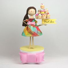 I love this custom cake topper for a bakery called Dina Cakes (I assume!) by The Small Object. Totally wonderful!
