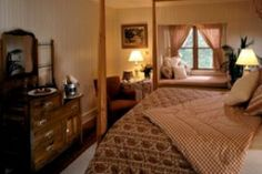 Room 12: Traditional Guest Room located on the third floor with a queen bed, lake view window seat, and a private bathroom with a tiled shower. $359.00 MAP, $319.00 B&B