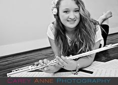 Senior Pose with flute. Way more creative than playing it, or holding it by your head/shoulders. Love this Picture :)