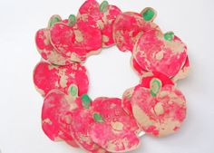 apple print wreath -- perfect for fall (apple half, paint, glue, paper plate ring, and presto!)