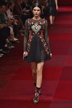 Roses were all the rage at the Dolce & Gabbana Spring 2015 show. Kendall looked totally romantic with this long-sleeved frock, printed boots, and dark maroon lip.