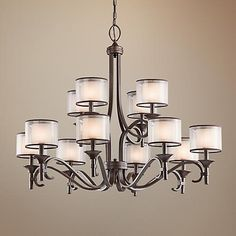 With double glass shades, this Mission bronze chandelier from Kichler has an updated traditional look.