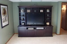 A new entertainment center that's big enough to hold 50 inch TV and lots of movies!
