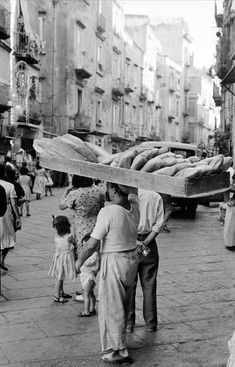 Baker carries a tray of bread - Italy, 1957, by Peter Gullers. Tumblr
