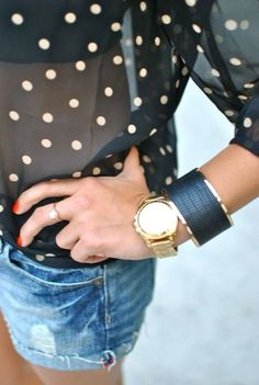 A black polka dot chiffon long sleeve blouse and blue denim shorts feel perfectly suited for weekend activities of all kinds.  Shop this look for $66:  http://lookastic.com/women/looks/blue-shorts-gold-watch-black-long-sleeve-blouse-black-bracelet/2788  — Blue Denim Shorts  — Gold Watch  — Black Polka Dot Chiffon Long Sleeve Blouse  — Black Leather Statement Bracelet