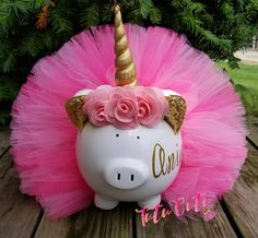 Unicorn tutu piggy Bank! A must have for all unicorn owners! This piggy is wearing a pink tutu teal tutu. It also has a unicorn horn and flowers attached. Bank has a removable stopper so no need to break when its time to remove money. Colors can be changed upon request. Name can be added or